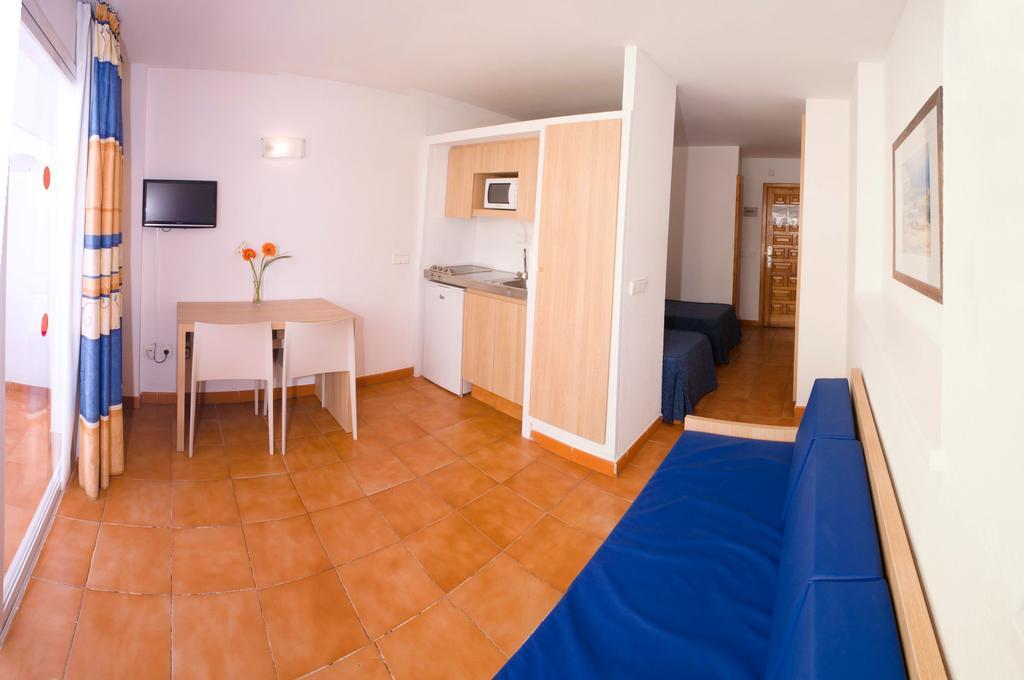 Sea View Cozy Apartments with Pool SAN ANTONIO CEPASAN Living Room